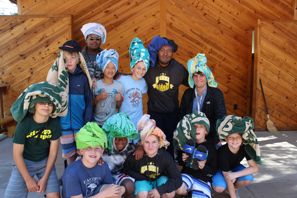 A group of boys pose with their counselors at Gold Arrow Camp in California