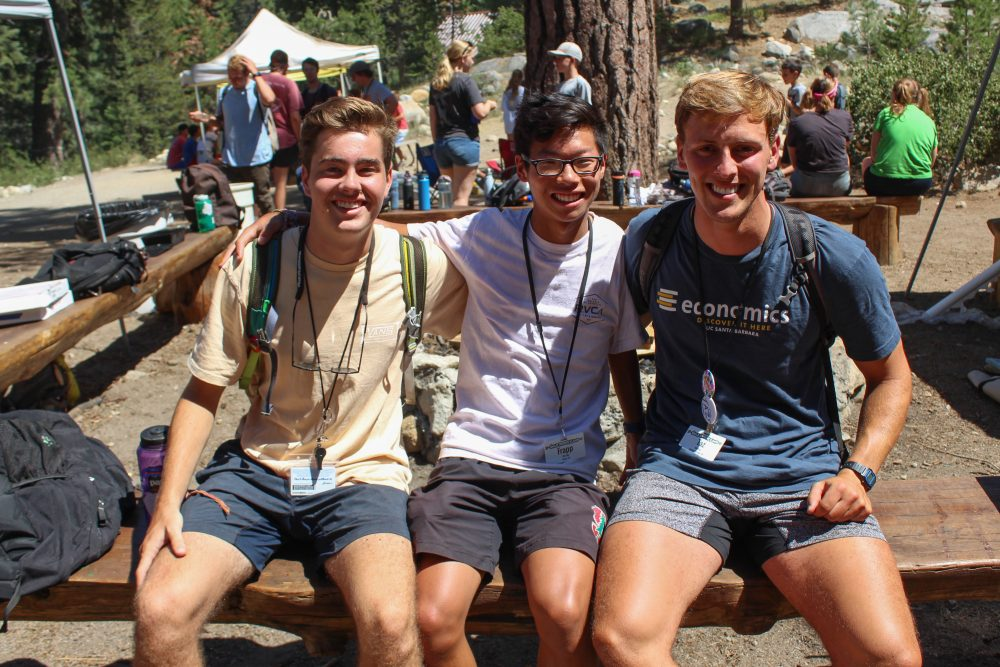 Three summer camp counselors smile for a picture at Gold Arrow Camp in California