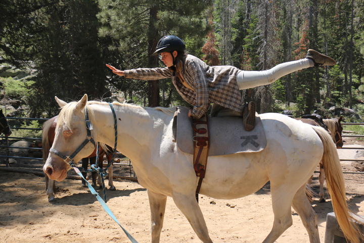A camper at Gold Arrow Camp practices vaulting on a horse at a summer camp in California